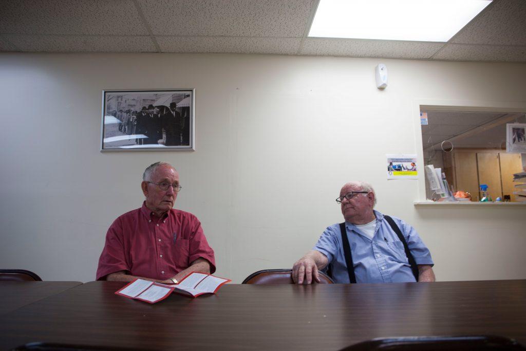Dallas County Registrar Carl Nelson, 76, speaks to fellowregistrar, Bobby Willis, 80, at Ebenezer Baptist Church during a voter registration drive in Selma.(Photo by Jeffrey Pierre/News21)
