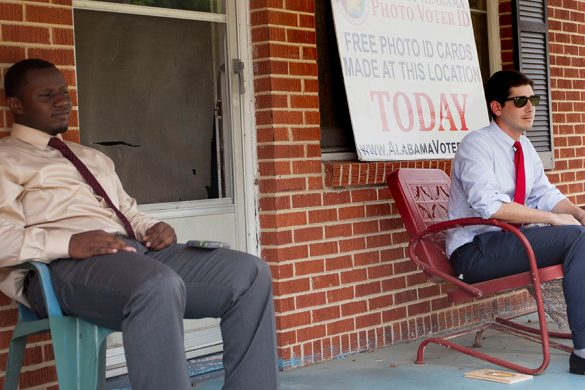 Todd Osanna and Trevin Flucker, two interns  from the Alabama secretary of state's office, wait outside a home in Selma. The two, who were sent to register voters, spent the day waiting – no one came. (Photo by Jeffrey Pierre/News21)