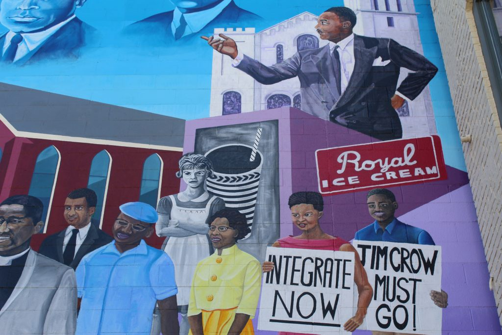 This mural in Durham, North Carolina, illustrates the Civil Rights movement as black residents fought for integration and voting rights. (Photo by Phillip Jackson/News21)