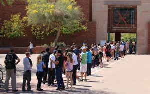 Voters wait in line for more than an hour Tuesday at the Arizona Historical Society Museum in Tempe. (Photo by Grecia Drabos/Cronkite News)