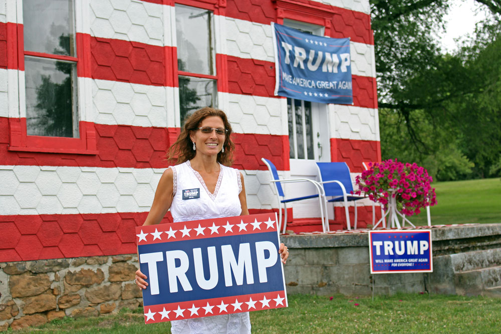 Leslie Rossi, a landlord in Westmoreland County, Pennsylvania, painted her house like an American flag to raise awareness for Donald Trump and voting for his delegates. Despite being a political advocate for the first time, Rossi said she's not afraid to deal with people damaging her Trump signs. (Photo by Emily Mills/News21)