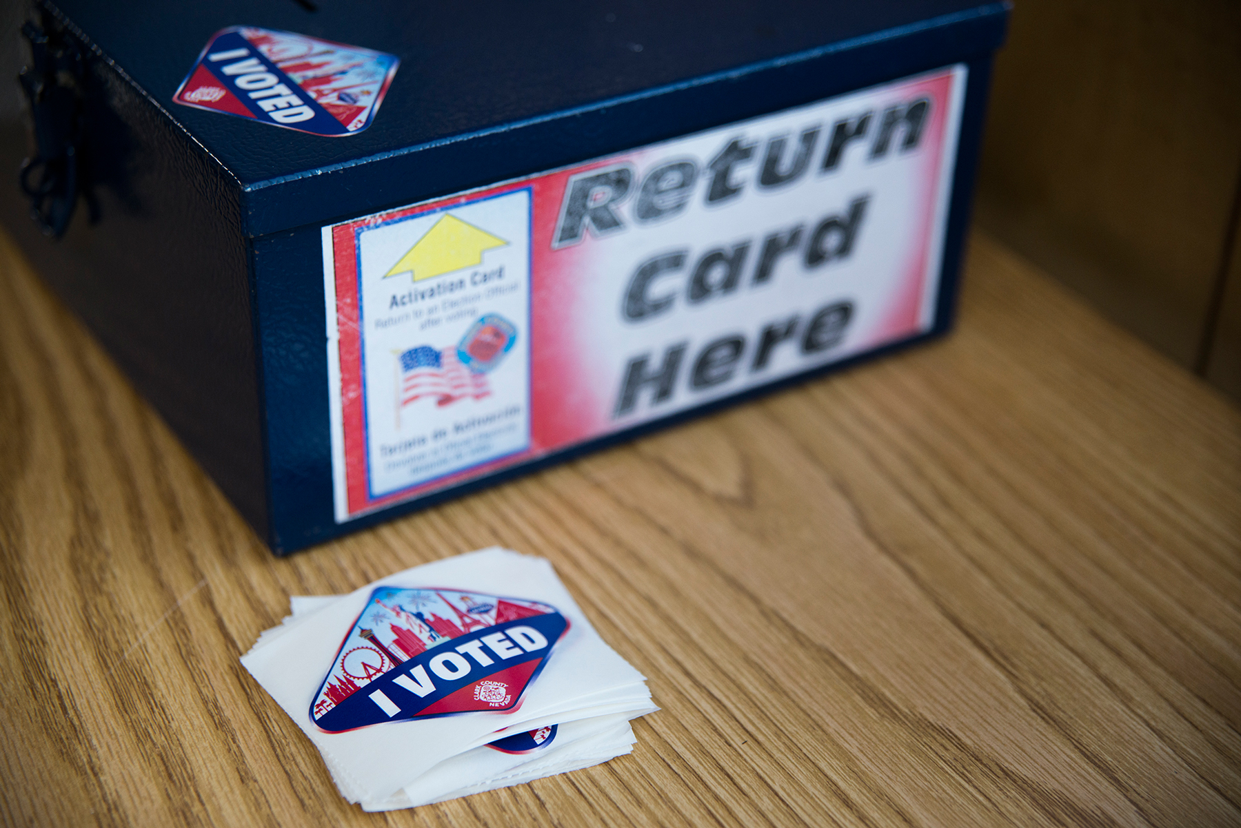 "After casting their ballots, voters in Clark County deposit the cards they use to vote in this box and receive an ""I voted"" sticker that resembles the Las Vegas welcome sign. (Roman Knertser/News21)"