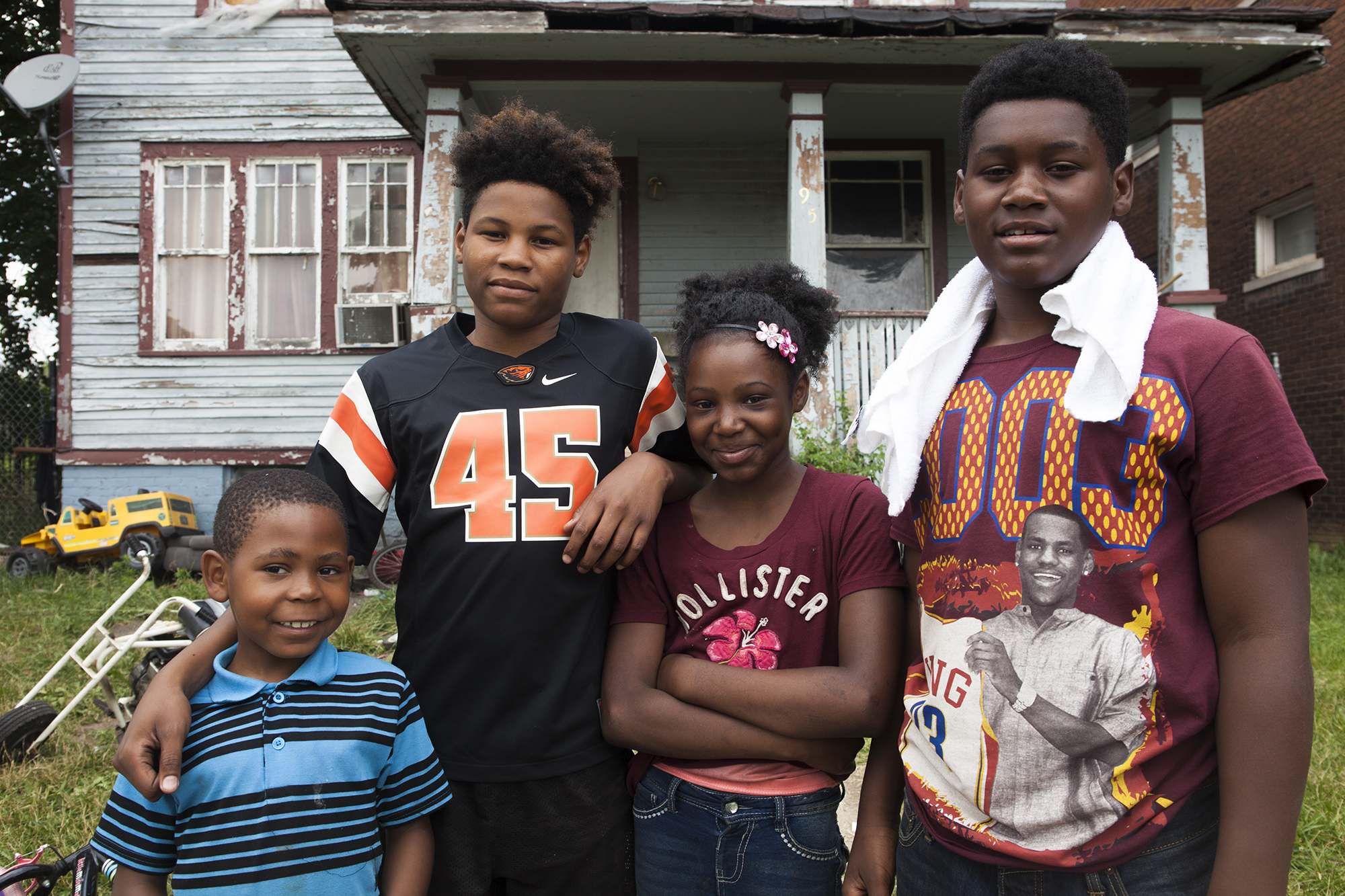 Lashanda Mayberry's children attended a Highland Park, Michigan, charter school, one of the few schools left in the suburb. Mayberry's children, pictured from right, are Tazeon, 15, Myaira, 11, and Keon, 13. Also pictured is Mayberry's nephew, Armani, 7. (Jeffrey Pierre/News21)