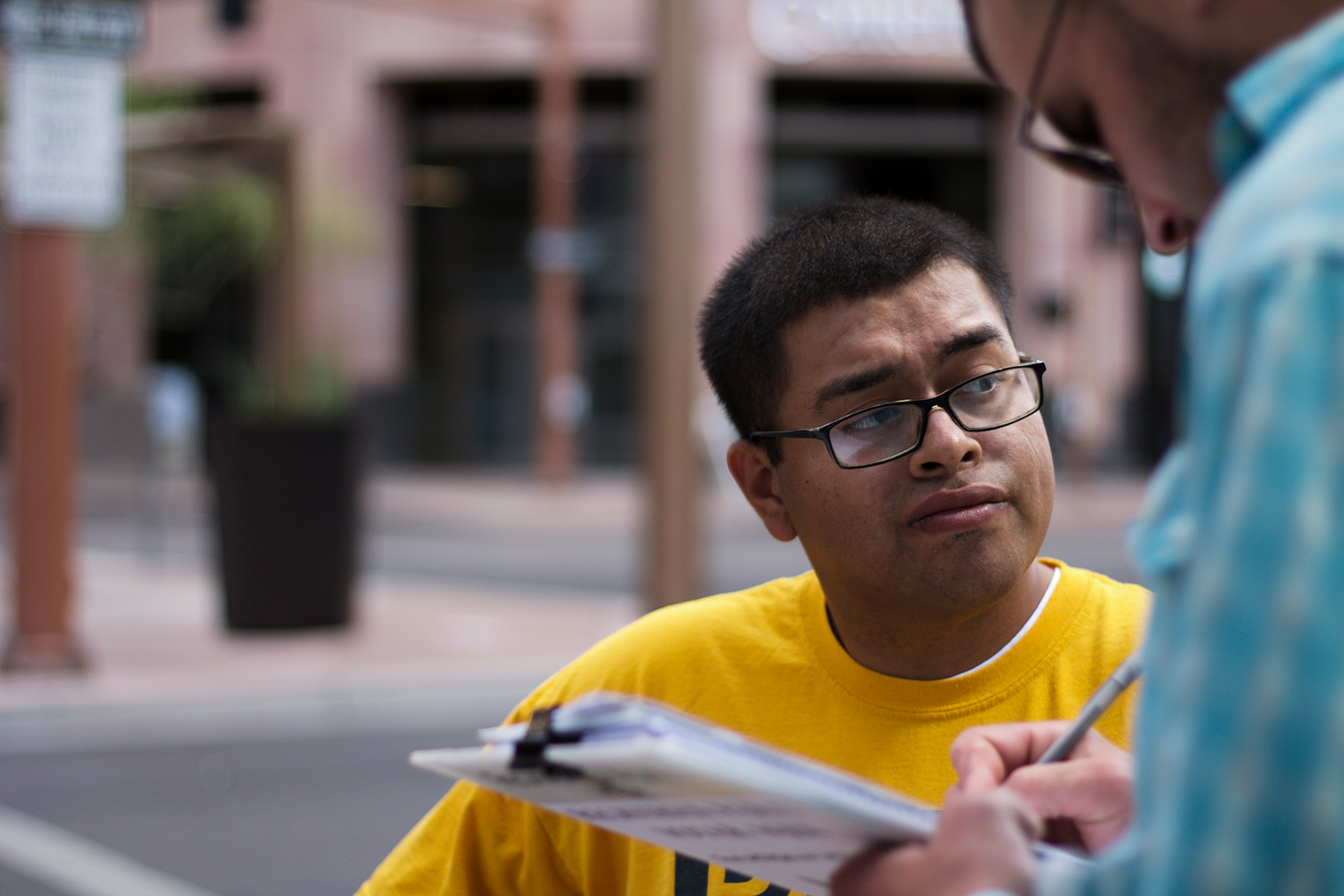 Jose Barboza, a Promise Arizona volunteer, registers voters in Phoenix. Thirteen cases of double voting were prosecuted in the state since 2012. (Courtney Columbus/News21)