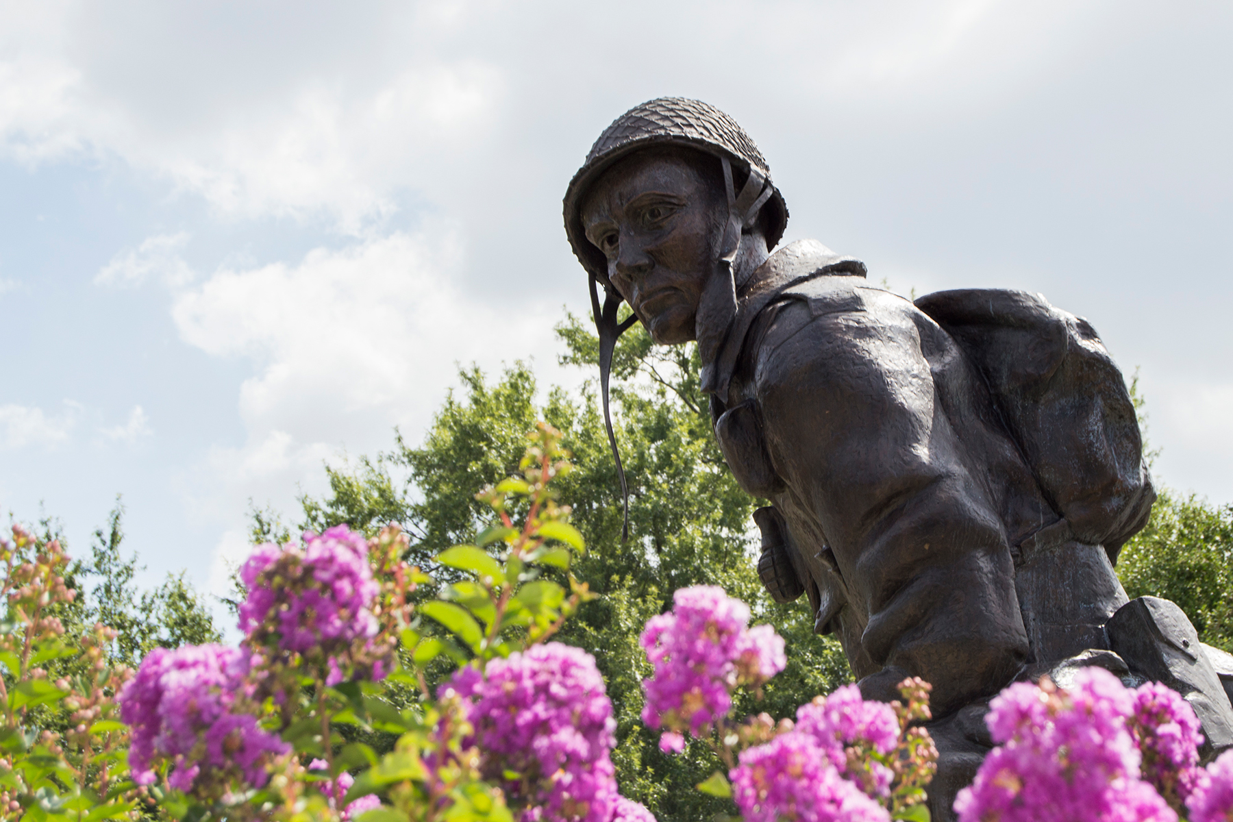 "The ""Iron Mike"" statue on the grounds at Fort Bragg in North Carolina represents the ""courage, dedication, and traditions"" of paratroopers from the 82nd Airborne Division. (Michael Olinger/News21)"