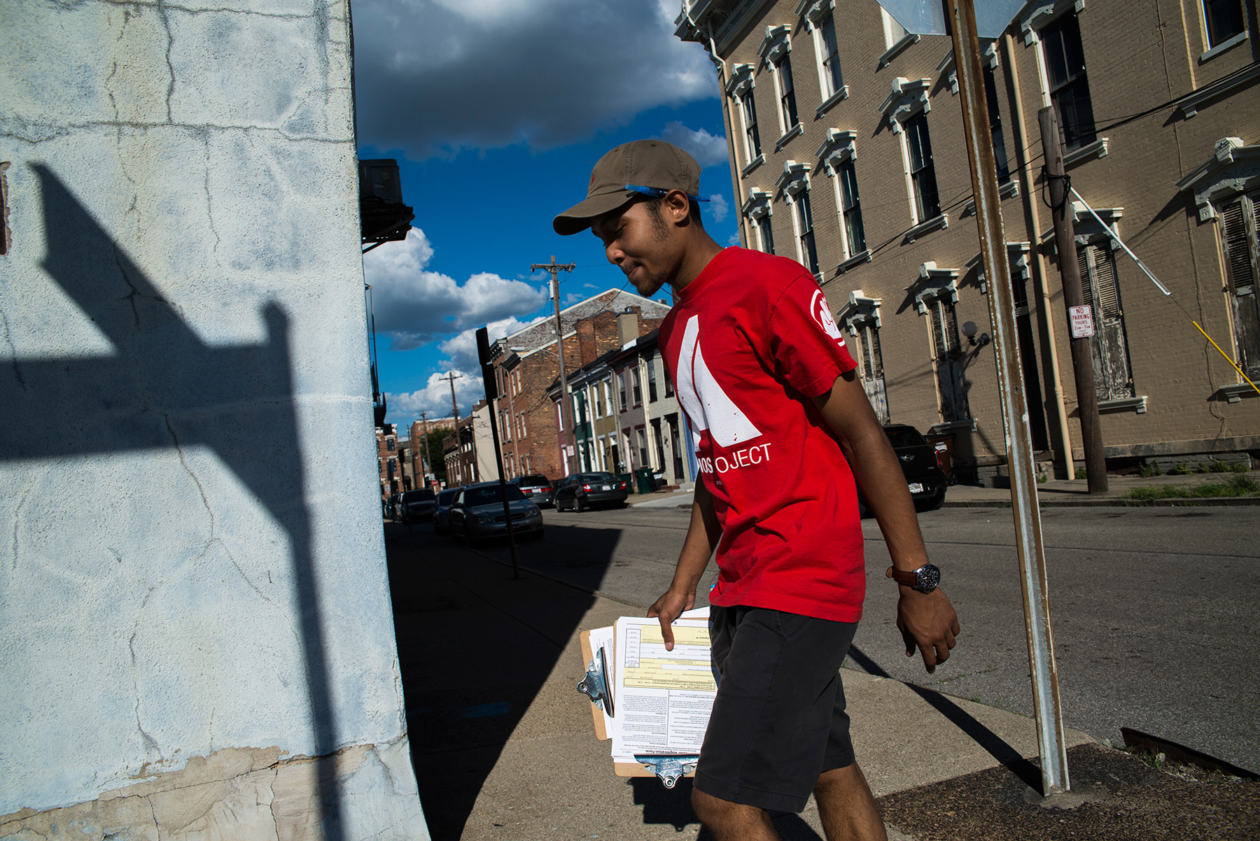 Dallas Stokes, a volunteer for the AMOS Project, a nonprofit social justice organization in Cincinnati, registers people to vote. Ohio is one of  several states where politicians have claimed voter fraud is a problem. (Roman Knertser/News21)