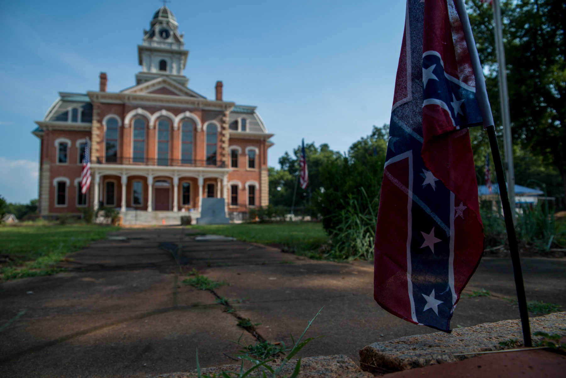 The Hancock County courthouse is in the county seat of Sparta, Georgia. Across from the courthouse a Confederate flag is wedged into the bricks of the Civil War memorial dedicated to those who served in the Confederacy. Sparta's population is nearly 80 percent black. (Roman Knertser/News21)