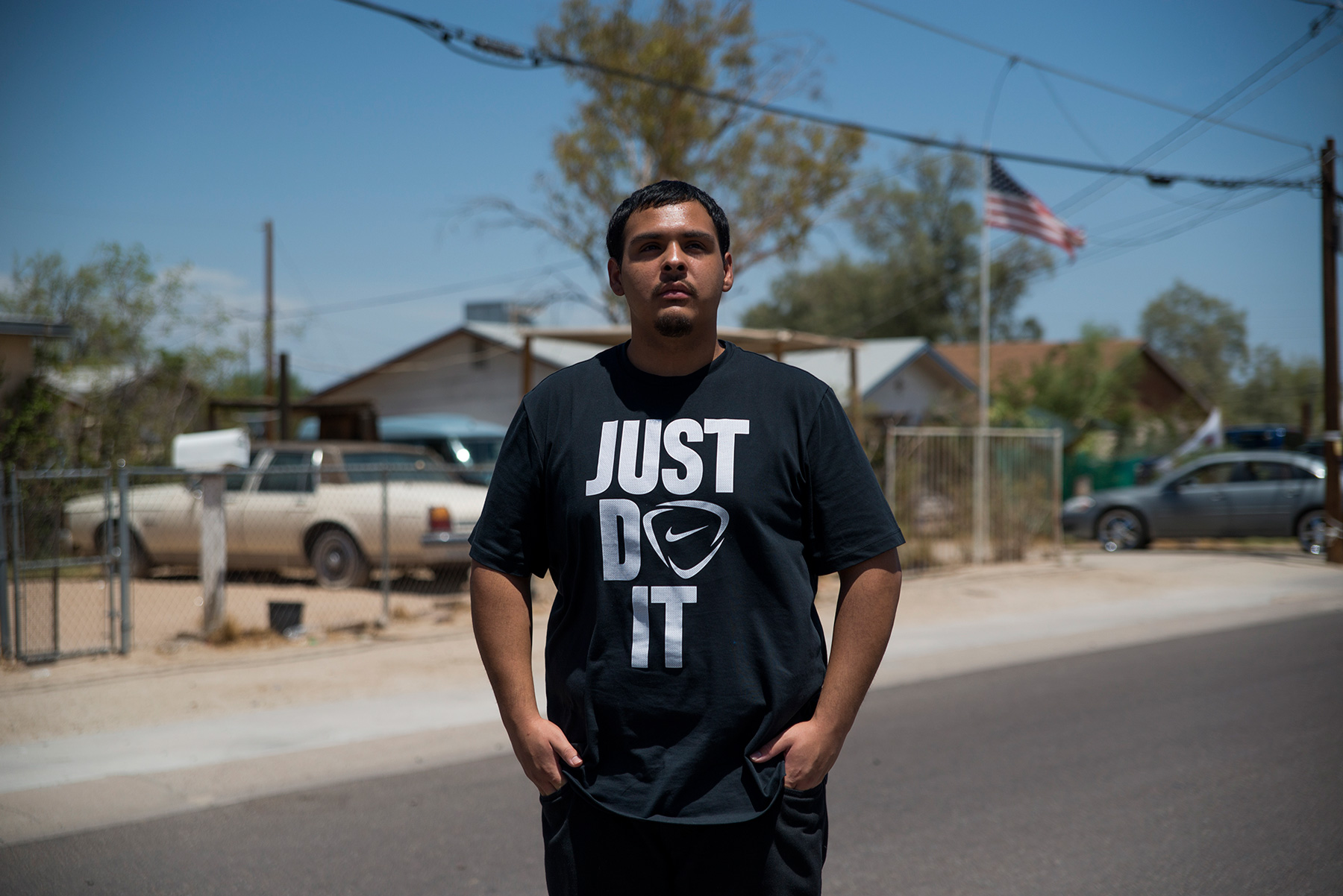 David Castorena, 24, of Chandler, Arizona, stands in the street of a small, largely Latino community in Arizona where he attends church. Castorena said he does not plan to vote in the November election because he thinks Donald Trump will win either way. (Roman Knertser/News21)
