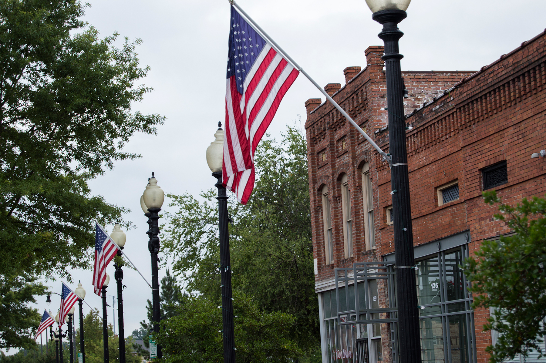 A row of flags greets pedestrians on Person Street in downtown Fayetteville, home to a considerable population of active duty military personnel and veterans. (Michael Olinger/News21)