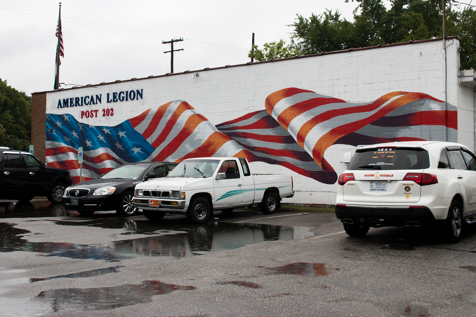 "This American flag mural at American Legion Post 202 in Fayetteville gained national notoriety when it was featured in a segment on the ""Steve Harvey"" show.  (Michael Olinger/News21)"