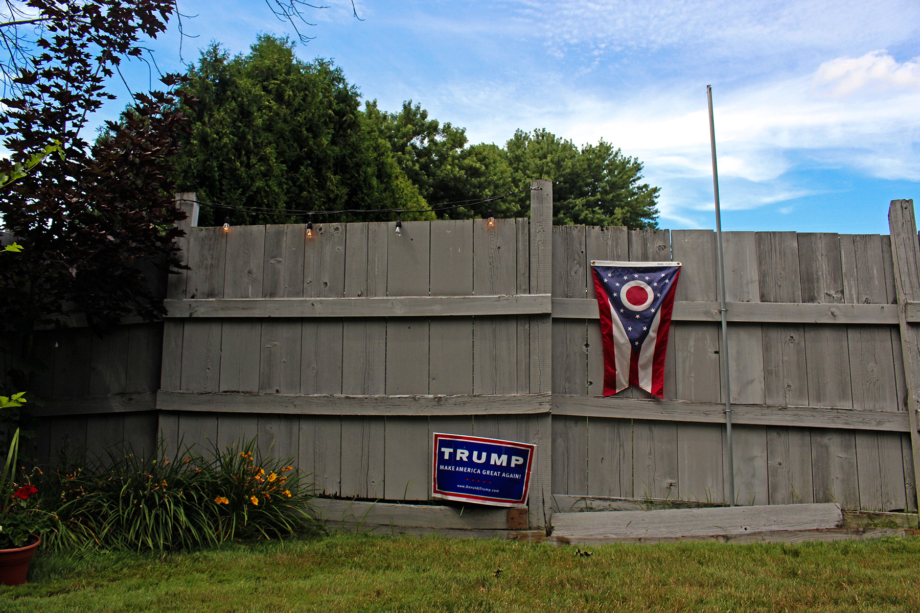 A Donald Trump campaign sign and Ohio state flag decorate the backyard of Kathy Miller, the Mahoning County chairwoman for Trump, in Boardman, Ohio. Miller is leading a grassroots movement encouraging Democratic voters to vote for Trump in November's general election. (Emily Mills/News21)