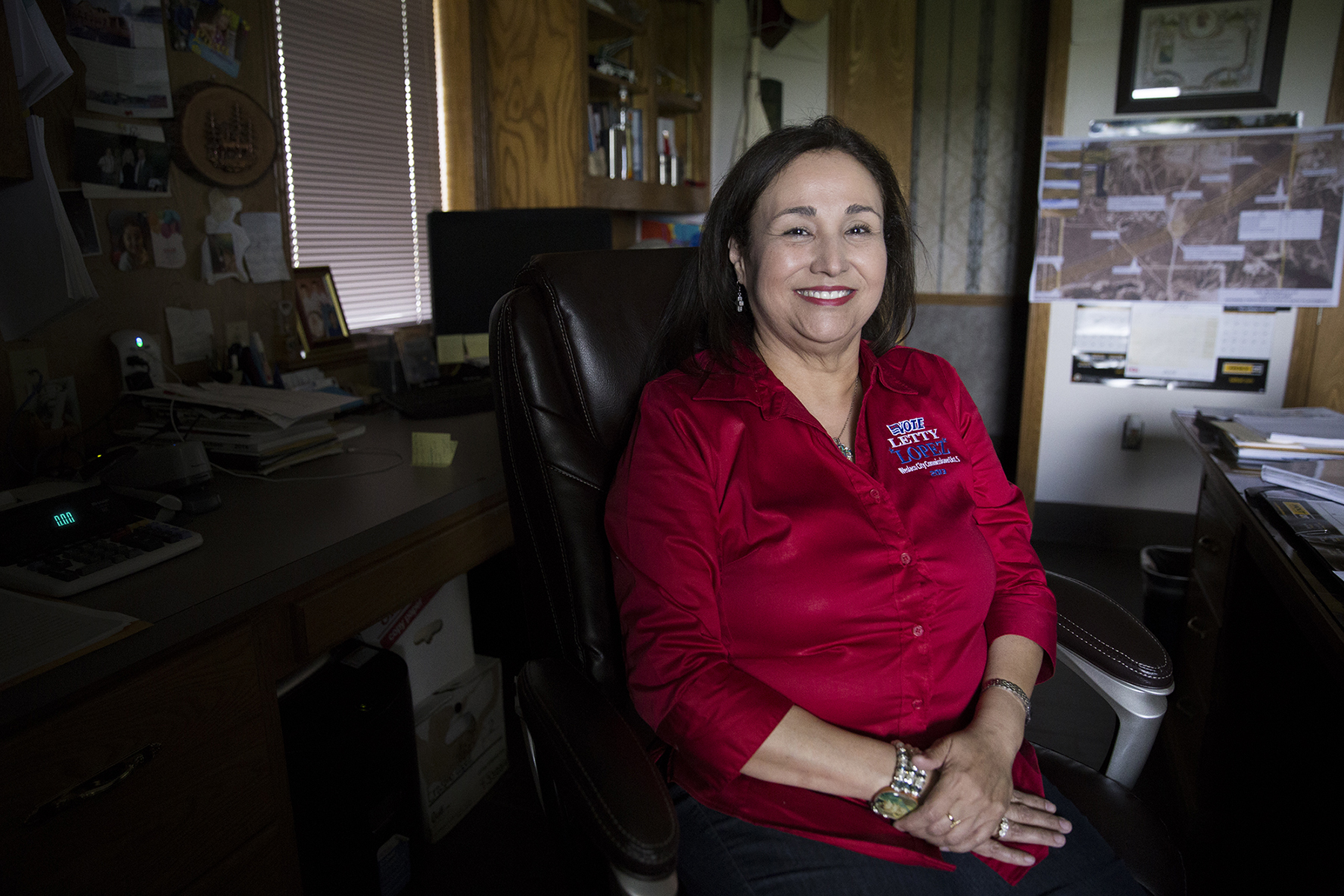 Letty Lopez, a city commissioner in Weslaco, Texas, poses for a portrait in her office. Although she originally ran for commissioner in November 2013, it wasn't until a special election two years later that she could take the position. Lopez contested the 2013 election after falling short by 16 votes. She discovered elderly citizens had not filled out their mail-in ballots on their own. (Pinar Istek/News21)