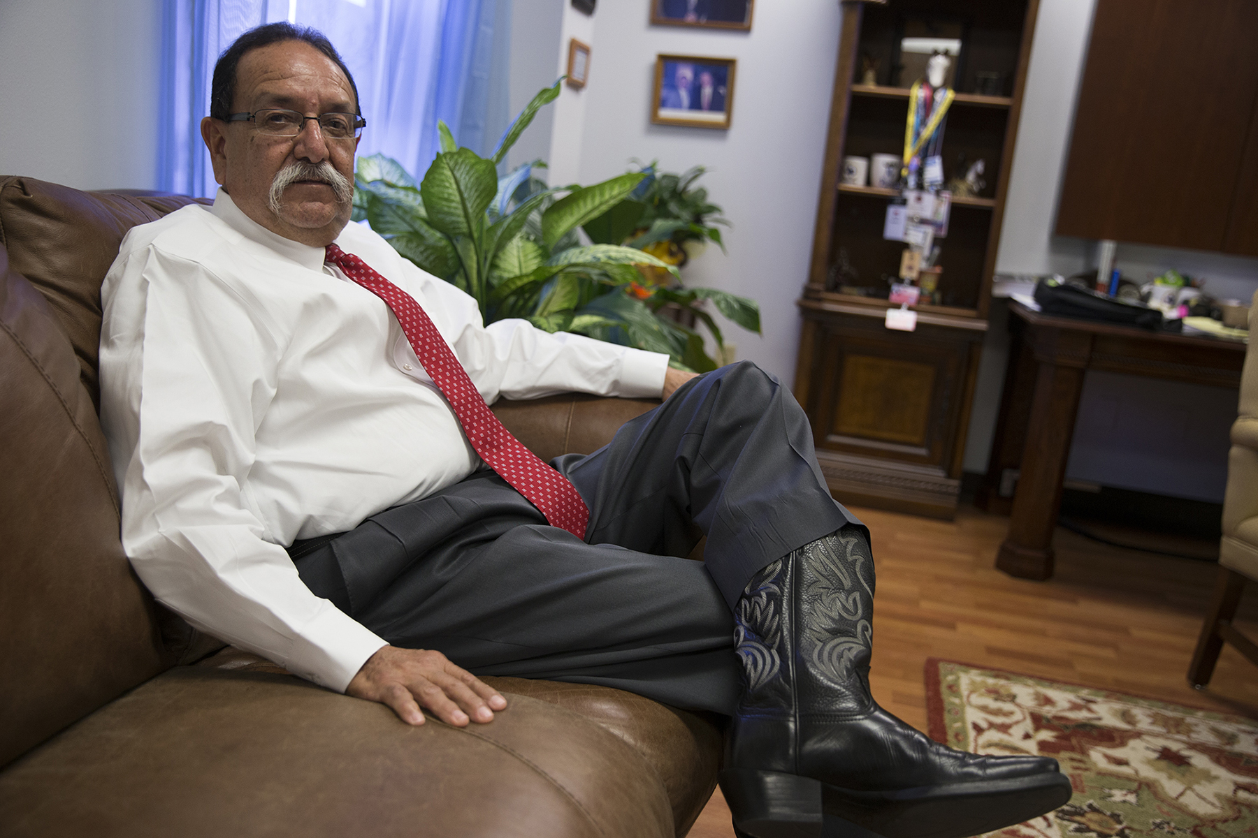 "Luis Saenz, the district attorney in Cameron County, Texas, discusses voter fraud in his office in Brownsville. Saenz's office assisted the state's attorney general with prosecuting six women who were arrested for mail-in ballot fraud during the 2012 Democratic primary runoff. Mail-in ballot harvesters — or ""politiqueras"" — are not as prevalent in the Rio Grande Valley after the 2012 arrests, Saenz said. (Pinar Istek/News21)"