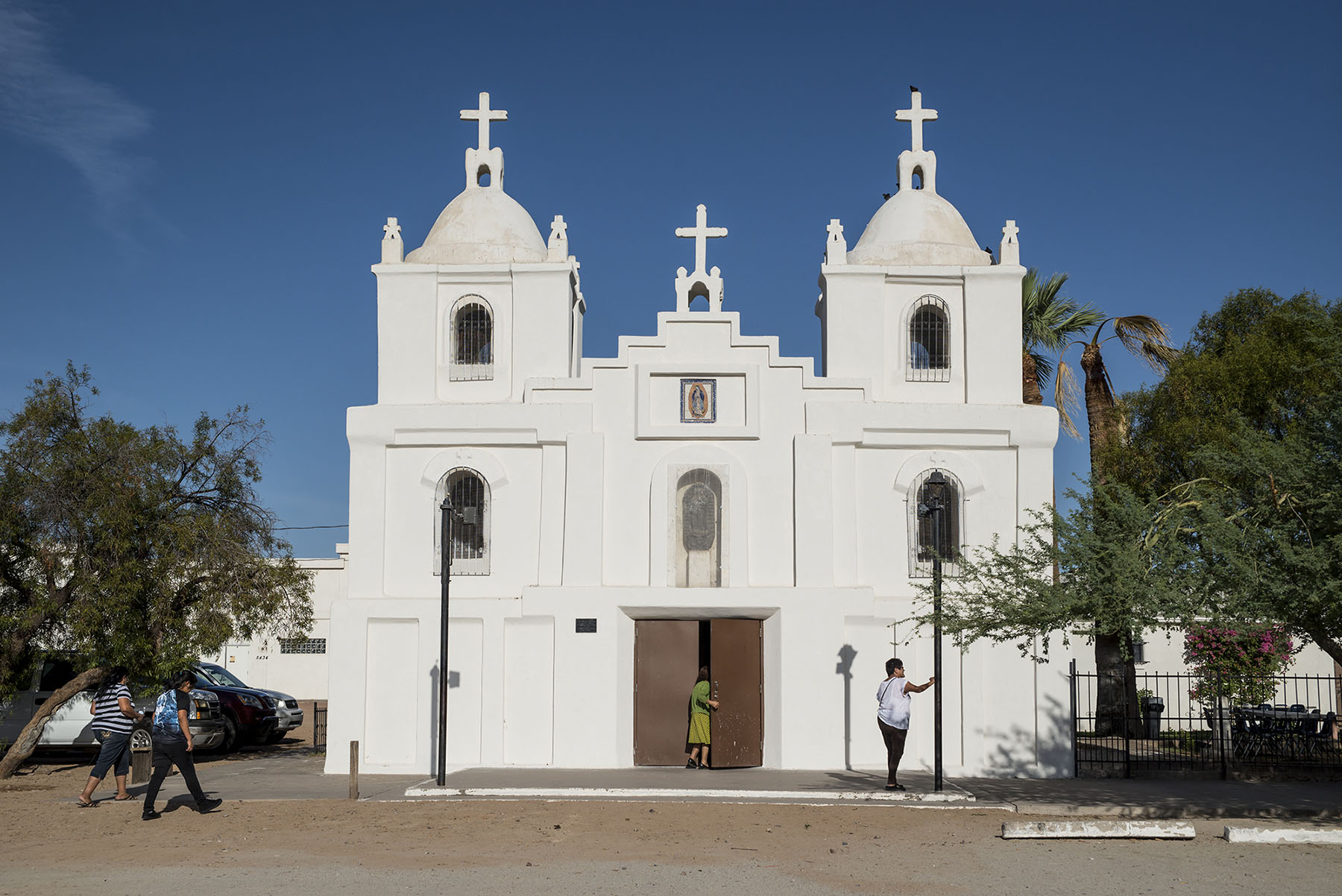Guadalupe, Arizona, has a majority Latino population, and its Our Lady of Guadalupe Church draws Latinos from nearby towns who say it reminds them of churches in Mexico. (Roman Knertser/News21)