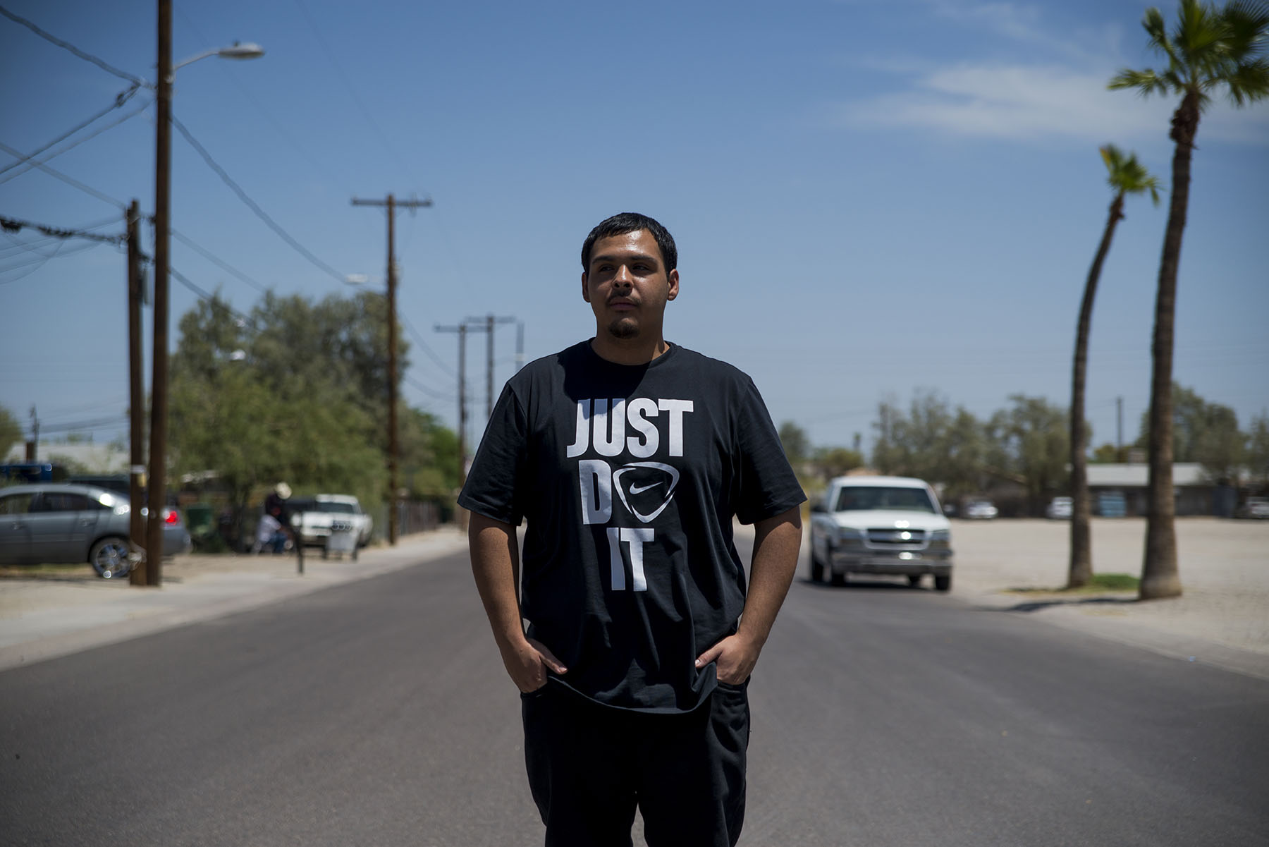 David Castorena, 24, of Chandler, Arizona, stands in the street of a small, largely-Latino community where he attends church. Castorena does not plan to vote in the November election because he thinks Donald Trump will win either way. (Roman Knertser/News21)