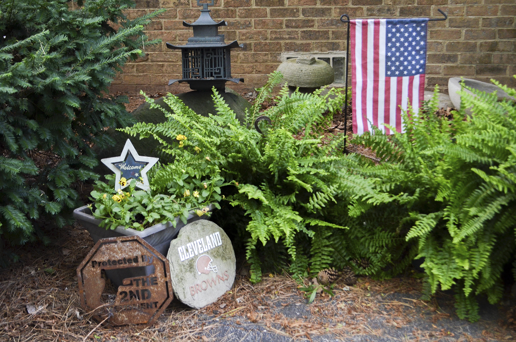 Kathy Miller, the Mahoning County chairwoman for Donald Trump, decorated her garden in Boardman, Ohio, with a pro-gun-rights sign, a Cleveland Browns sign and an American flag. She said people are fed up with the direction of the country and are looking to Trump for change. (Lian Bunny/News21)