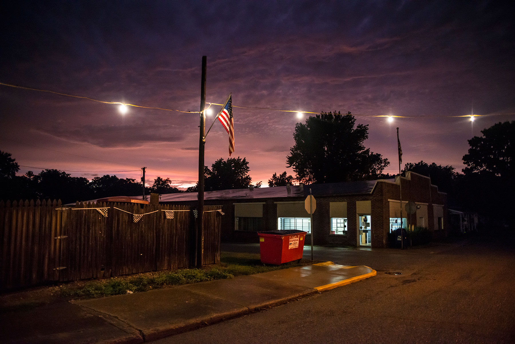 A brilliant sunset fades after a thunderstorm in Newport, Indiana. Residents said they did not have trouble voting because the small-town atmosphere means poll workers know all the townspeople, making it easier to prove their identity at the polls. Indiana was the first state to pass a strict photo ID law. (Roman Knertser/News21)