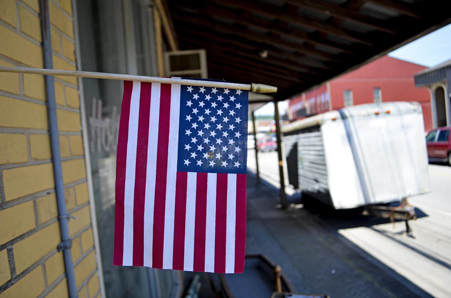An American flag decorates a Clay County, Tennessee, street of empty buildings and economically struggling small businesses. The county has a 24 percent poverty rate. (Lian Bunny/News21)